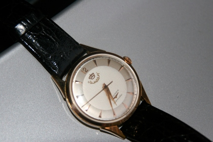 longines with crown n arabic letter